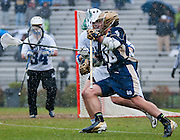 Sean Rogers Attack #18 drive son Duke defender. The third-ranked Fighting Irish defeated sixth-ranked Duke, 13-5, in men's lacrosse action on a snowy Saturday afternoon at Koskinen Stadium in Durham, N.C.