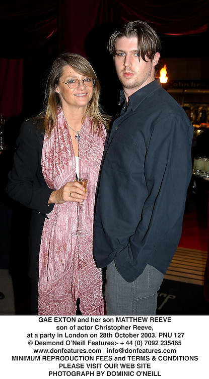 GAE EXTON and her son MATTHEW REEVE son of actor Christopher Reeve, at a party in London on 28th October 2003.PNU 127