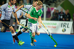 Ireland's Kirk Shimmins breaks with the ball. Ireland v Germany - Unibet EuroHockey Championships, Lee Valley Hockey & Tennis Centre, London, UK on 23 August 2015. Photo: Simon Parker