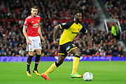 Burton Albion midfielder Hope Akpan (21) and Manchester United midfielder Michael Carrick (16) during the EFL Cup match between Manchester United and Burton Albion at Old Trafford, Manchester, England on 19 September 2017. Photo by Richard Holmes.