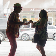 JUNE 9, 2016---MIAMI, FLORIDA<br /> Orestes Sosa, dances with a tourist from Mexico as he plays the maracas with a trio performing mostly Cuban songs in one of Little Havana's hottest spots Ball and Chain.<br /> (Photo by Angel Valentin/Freelance)