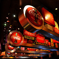 Brief History of Coca-Cola&rsquo;s Origin in Atlanta, Georgia <br /> In 1866, pharmacist John Pemberton began experimenting to develop a non-narcotic pain medicine. An early extract featuring the kola nut was named, &ldquo;Pemberton&rsquo;s French Wine Cola.&rdquo; Twenty years later, he worked with an Atlanta drugstore owner Willis Venable to create a fountain drink. Then, Frank Robinson became a partner, called the beverage Coca-Cola and was the driver for the early success. You can enjoy learning what happened during the next 130 years at the World of Coca-Cola. This fascinating museum on 20 acres opened in 2007 near the company&rsquo;s headquarters.