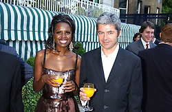 Actress JUNE SAPONG and ALAN EDWARDS head of the Outside organisation at a party hosted by Andrew neil and The Business Newspaper held at The Ritz, Piccadilly, London on 12th July 2005.<br /><br />NON EXCLUSIVE - WORLD RIGHTS