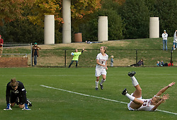 Virginia midfielder/defender Nikki Krzysik (23) reacts after scoring the game winning goal past William and Mary goalkeeper Jackie Bowman (1).  The Virginia Cavaliers defeated the William and Mary Tribe 1-0 in the second round of the NCAA Women's Soccer tournament held at Klockner Stadium in Charlottesville, VA on November 18, 2007.