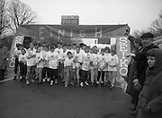 First All-Traveller Mini Marathon.    (R53)..1987..05.04.1987..04.05.1987..5th April 1987..Today saw the running of the first All-Traveller Mini Marathon in aid of Trocaire the World Aid Agency. The race was run over a 10k course in the Phoenix Park, Dublin. Bishop Eamon Casey a patron of the charity was on hand to lend support...Ready,Steady,Go. Image shows Bertie Ahern TD,.Klaxon in hand about to start the race. .Bishop Casey urges supporters to step back.