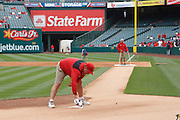 ANAHEIM, CA - MAY 08:  Groundskeepers prepare the field for the game between the Cleveland Indians and the Los Angeles Angels of Anaheim on Sunday, May 8, 2011 at Angel Stadium in Anaheim, California. The Angels won the game 6-5. (Photo by Paul Spinelli/MLB Photos via Getty Images)