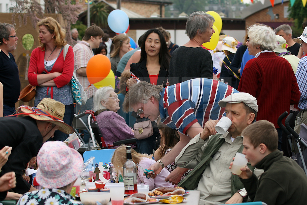 Cambridge, UK  29/04/2011. The Royal Wedding of HRH Prince William to Kate Middleton. Street Party with man in flat cap with young an old on Kimberley Road Cambridge city centre. Photo credit should read Jason Patel/LNP. Please see special instructions. © under license to London News Pictures