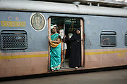 Passengers inside a Women-Only carriage on a train arriving at Chhatrapati Shivaji Terminus in Mumbai