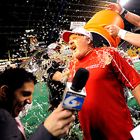 Hillcrest High head coach Darin Owns is doused with gatorade by quarterback Matt Astel following the team's 55-35 victory over Jerome High in the Idaho 4A State Championship at Holt Arena in Pocatello on November 21, 2008. (Nate Chute/Post Register)
