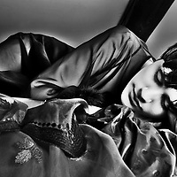 A young woman laying on a bed