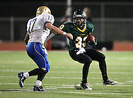 Kennedy's Trevor Heitland (33) tries to juke Wahlert's Sam Koenig (17) on a run during the first half of the game between Cedar Rapids Kennedy and Dubuque Wahlert at Kingston Stadium in Cedar Rapids on Friday night, October 21, 2011.