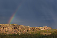 Rainbow over Otowi Mesa, with the site of Otowi Ruins visible in the clear to the right side, © 2011 David A. Ponton