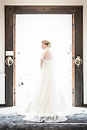 A Danish bride stands in a church doorway, bathed in sunlight. The wedding took place in Frederiksberg, a suburb of Copenhagen