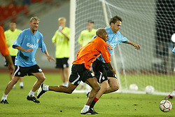 BANGKOK, THAILAND - Wednesday, July 23, 2003: Liverpool's Dietmar Hamann and El-Hadji Diouf during a training session in at the Rajamangala National Stadium. (Pic by David Rawcliffe/Propaganda)