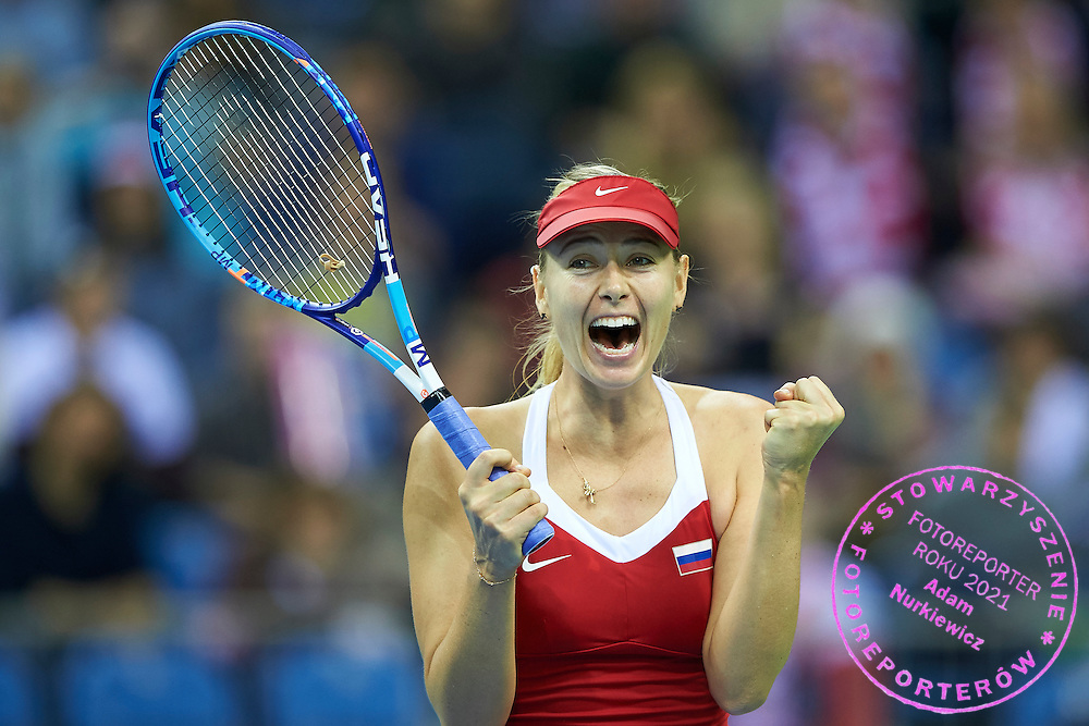 Maria Sharapova from Russia celebrates her winning point and victory the whole game during Second Day of the Fed Cup / World Group 1st round tennis match between Poland and Russia at Tauron Krakow Arena on February 8, 2015 in Cracow, Poland.<br /> <br /> Poland, Cracow, February 8, 2015<br /> <br /> Picture also available in RAW (NEF) or TIFF format on special request.<br /> <br /> For editorial use only. Any commercial or promotional use requires permission.<br /> <br /> Adam Nurkiewicz declares that he has no rights to the image of people at the photographs of his authorship.<br /> <br /> Mandatory credit:<br /> Photo by &copy; Adam Nurkiewicz / Mediasport