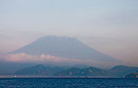 Looking back at Agung at dawn on Bali on our way to Nusa Penida.