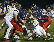 NEW HOPE, PA -  OCTOBER 25: Jenkintown's Julian Goldhill (2) is gang tackled by New Hope Solebury defenders in the first half October 25, 2013 in New Hope, Pennsylvania.  (Photo by William Thomas Cain/Cain Images)