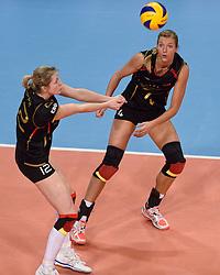 04-01-2016 TUR: European Olympic Qualification Tournament Nederland - Duitsland, Ankara <br /> De Nederlandse volleybalvrouwen hebben de eerste wedstrijd van het olympisch kwalificatietoernooi in Ankara niet kunnen winnen. Duitsland was met 3-2 te sterk (28-26, 22-25, 22-25, 25-20, 11-15) / Heike Beier #12 of Germany, Maren Brinker #4 of Germany