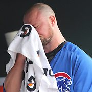 NEW YORK, NEW YORK - July 03: Pitcher Jon Lester #34 of the Chicago Cubs in the dugout after being pulled by Manager Joe Maddon #70 of the Chicago Cubs after giving up seven runs in the second innings during the Chicago Cubs Vs New York Mets regular season MLB game at Citi Field on July 03, 2016 in New York City. (Photo by Tim Clayton/Corbis via Getty Images)