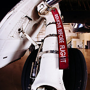 The wheel of a private jet is highlighting a Remove Before Flight safety mechanism at Garfield County Regional Airport in Colorado.
