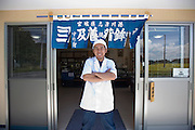 Zenya Oikawa, managing director of Oizen Shoten, stands at the entrance to the company's factory in Tome City, Miyagi Prefecture, Japan on 11 Sept. 2012.  Photographer: Robert Gilhooly