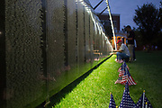 "Bob Thompson, an Athens resident, looks for names on ""The Wall That Heals"", a half-scale replica of the Vietnam Veterans Memorial in Bicentennial Park on September 15, 2017."