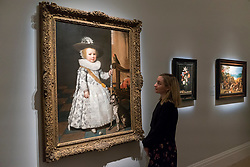 "© Licensed to London News Pictures. 29/11/2019. LONDON, UK. A staff member views ""Portrait of a Young Golfer"", 1626, by Jan Anthonisz Van Ravesteyn (Est. GBP120-180k) at the preview of Old Masters sales at Sotheby's, New Bond Street.  Works will be offered for sale on 4 and 5 December.  Photo credit: Stephen Chung/LNP"