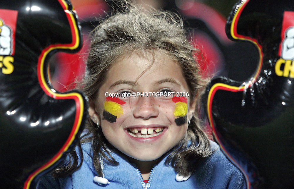 A young fan enjoying her time at the Super 14 match between the Waikato Chiefs and Queensland Reds at Waikato Stadium, Hamilton on Friday 3 March 2006. The Chiefs won the game 35:17. Photo: Andy Song/PHOTOSPORT