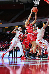 NORMAL, IL - December 04: Arielle Gonzalez-Varner gets possession of a loose ball before Simone Goods or Te Te Maggett during a college women's basketball game between the ISU Redbirds  and the Austin Peay Governors on December 04 2018 at Redbird Arena in Normal, IL. (Photo by Alan Look)