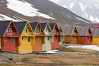 Simple designed row houses combine with strong contrasting color at Longyearbyen, Spitsbergen, Svalbard, Norway.