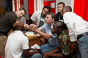 South African Plastic Surgeon Piet Coetzee with medical students and translators examine a young man with a cleft palette...Operation Smile South Africa.Clinique Ngaliema, Avenue Des Cliniques.KInshasa, DRC Mission, June 3rd-12th 2011..© Zute & Demelza Lightfoot.www.lightfootphoto.com...