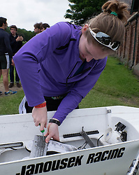 © Licensed to London News Pictures.13/06/15<br /> Durham, England<br /> <br /> A rower tightens the fixings for her shoes in her boat during the 182nd Durham Regatta rowing event held on the River Wear. The origins of the regatta date back  to commemorations marking victory at the Battle of Waterloo in 1815. This is the second oldest event of this type in the country and attracts over 2000 competitors from across the country.<br /> <br /> Photo credit : Ian Forsyth/LNP
