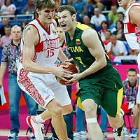 08 August 2012: Russia Andrei Kirilenko steals the ball from Lithuania Martynas Pocius during Team Russia vs Team Lithuania, during the men's basketball quarter-finals, at the 02 Arena, in London, Great Britain.