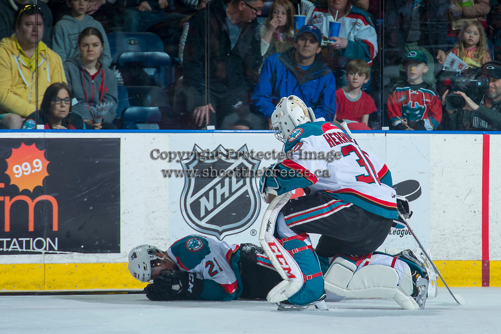 KELOWNA, CANADA - APRIL 30: Michael Herringer #30 comes to the aid of Devante Stephens #21 of the Kelowna Rockets after a hit from behind against the Seattle Thunderbirds on April 30, 2017 at Prospera Place in Kelowna, British Columbia, Canada.  (Photo by Marissa Baecker/Shoot the Breeze)  *** Local Caption ***