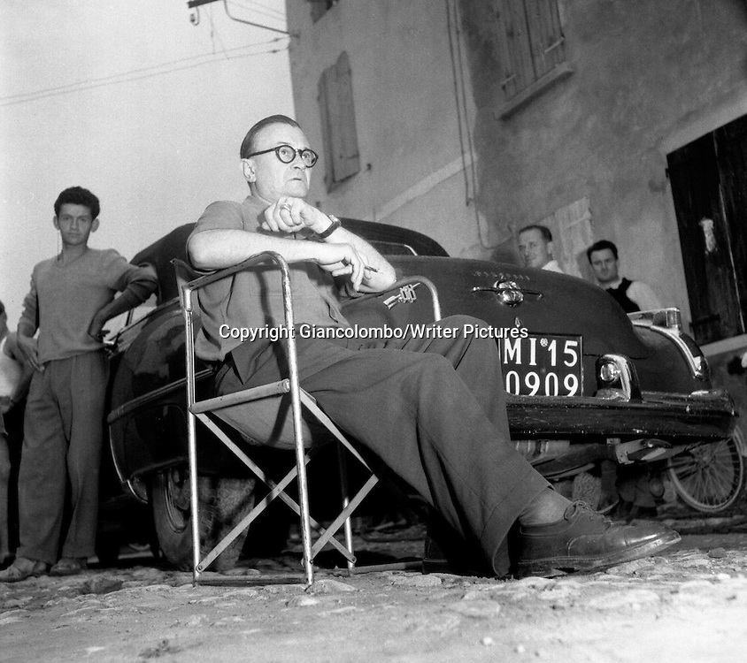 Julien Duvivier, director, on the set of the movie The Little World of Don Camillo, made out of Guareschi's  novel. Brescello, (Parma)<br /> 1951<br /> <br /> Photograph by Giancolombo/Writer Pictures<br /> <br /> WORLD RIGHTS, NO AGENCY, NO ITALY