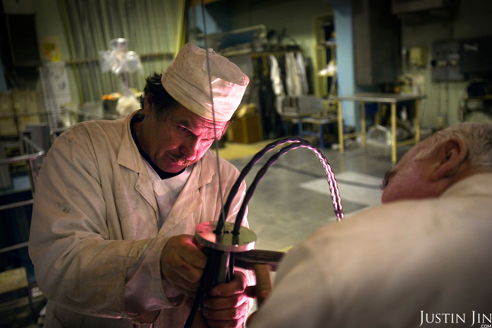 Technicians prepare tests at a research reactor, containing highly-enriched uranium, at the Moscow Civic Engineering Institute.