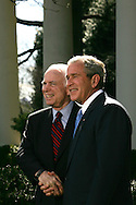 President George W. Bush and Republican Presidential nominee Senator John McCain R-AZ answer questions at a press conference in the Rose Garden of the White House on March 5, 2008.  Photograph: Dennis Brack