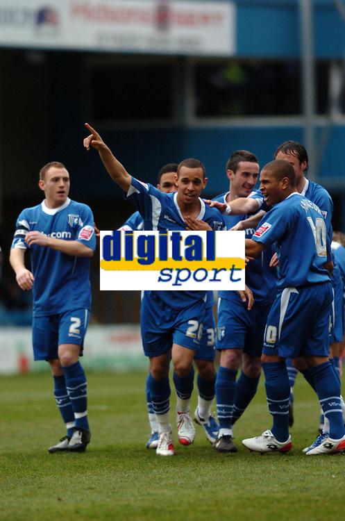 Photo: Tony Oudot/Richard Lane Photography. Gillingham v Shrewsbury Town. Coca-Cola Football League Two. 28/02/2009. <br /> Curtis Weston of Gillingham celebrates his opening goal with team mates