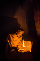 A priest reads by candlelight, Debre Maryam Korkor Church, Tigray, Ethiopia.