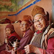 Elder nuns with prayer wheels - Pishu nunnery, Zanskar, Jammu-Kashmir, India, 2014