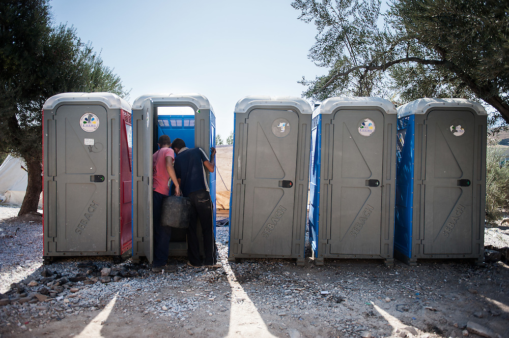 MSF contractors are inspecting the new portaloos they put in Kara Tepe camp in Lesvos, Greece.