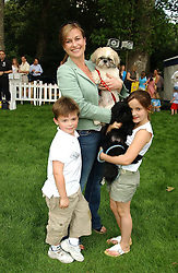 Radio presenter EMMA FORBES, her children LILLY and ? and dogs Scooby & Alfie at the Macmillan Cancer Relief Dog Day held at the Royal Hospital Chelsea South Grounds, London on 6th July 2004.