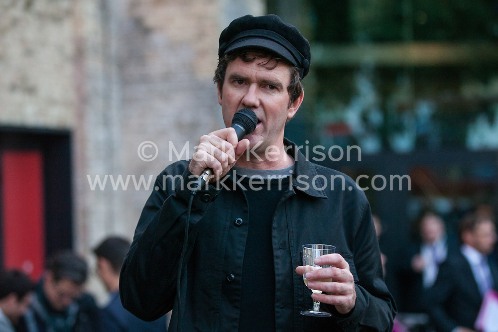 London, UK. 8 October, 2019. Simon Elmer of Architects for Social Housing (ASH) addresses a protest outside the award ceremony for the Riba Stirling Prize at the Roundhouse. ASH were protesting against the Royal Institute of British Architects' (RIBA) nomination of the architecture of social cleansing, estate demolition and housing privatisation for the Stirling Prize, against the false promotion of council-owned commercial housing development and management companies as a so-called 'renaissance in social housing' and against the association of the name of socially committed architect, the late Neave Brown, with the architecture of Neo-liberalism. Credit: Mark Kerrison/Alamy Live News