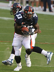 Wali Lundy (33)..UVA's Wali Lundy (33) receives a handoff from QB Marques Hagans (18) in action against WMU.  The Virginia Cavaliers defeated the Western Michigan Broncos 31-19 on September 3, 2005 at Scott Stadium in Charlottesville, VA.