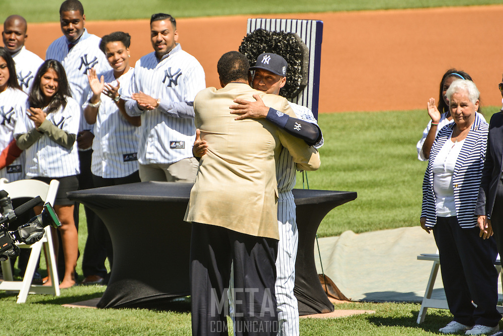 Derek Jeter embraces Yankee great Dave Winfield after his introduction.