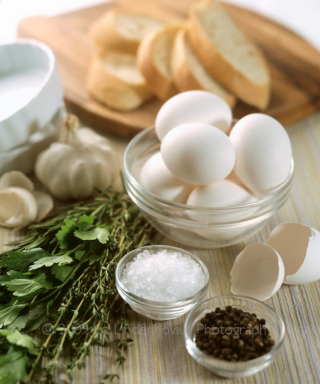 Ingredients to make baked eggs with herbs