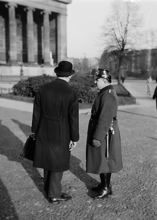 Policeman Conversing with Man in Hat, Berlin, circa 1931