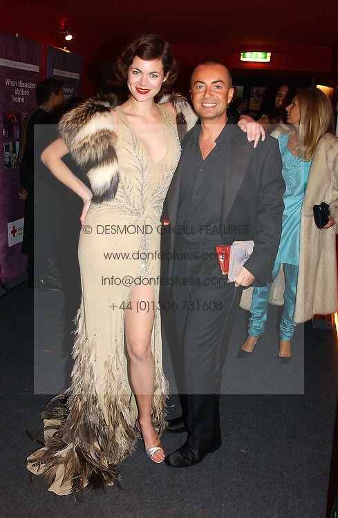"""Model JASMINE GUINNESS and fashion designer JULIEN MACDONALD at the 10th annual British Red Cross London Ball.  This years ball theme was Indian based - """"Yaksha - Yakshi: Doorkeepers to the Divine"""" and was held at The Room, Upper Ground, London on 1st December 2004.  Proceeds from the ball will aid vital humanitarian work, including HIV/AIDS projects that the Red Cross supports in the UK and overseas.<br /><br />NON EXCLUSIVE - WORLD RIGHTS"""