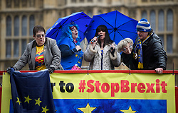 © Licensed to London News Pictures. 29/03/2018. London, UK. Anti-Brexit campaigners gather on a red bus outside the House of Parliament in Westminster, London a year ahead of the UK leaving the EU on March 29, 2019 . Photo credit: Ben Cawthra/LNP