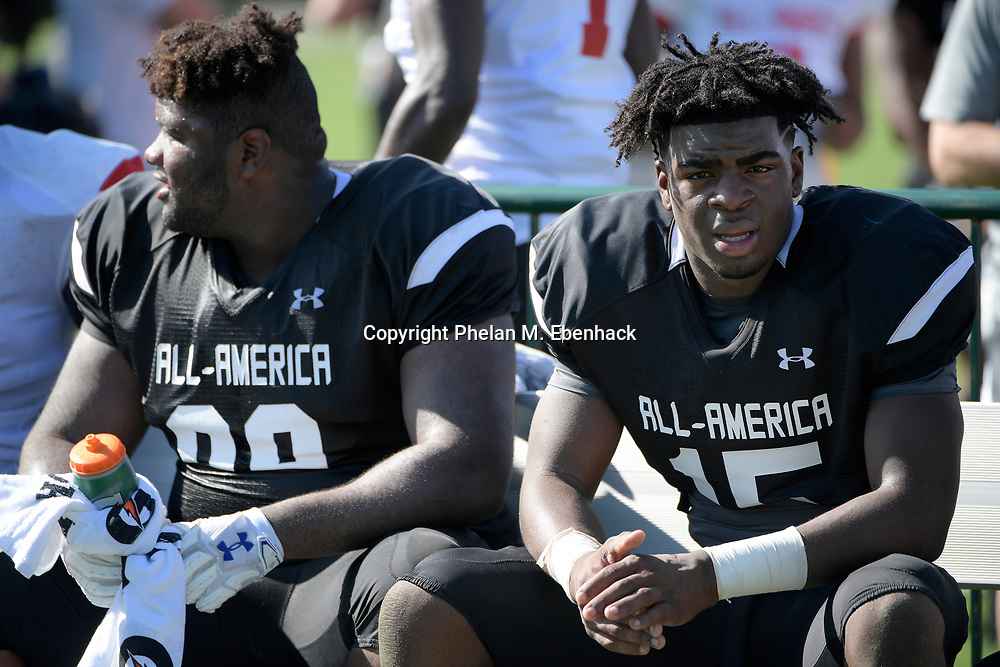 Team Armour defensive tackle Marvin Wilson (99) and defensive end Markaviest Bryant (15) rest during a practice for the Under Armour All-America football game in Lake Buena Vista, Fla., Wednesday, Dec. 28, 2016. (Photo by Phelan M. Ebenhack)